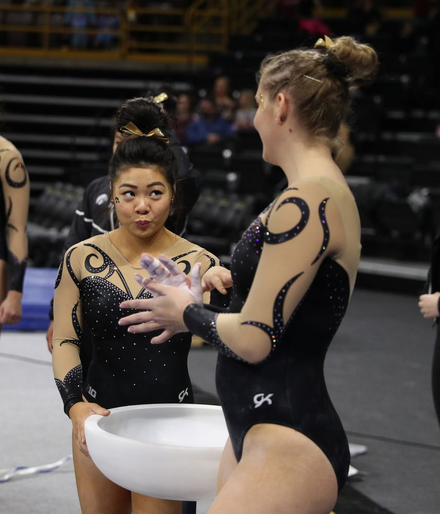 Iowa's Clair Kaji encourages teammate Emma Hartzler  before her routine on the beam during their meet against Southeast Missouri State Friday, January 11, 2019 at Carver-Hawkeye Arena. (Brian Ray/hawkeyesports.com)
