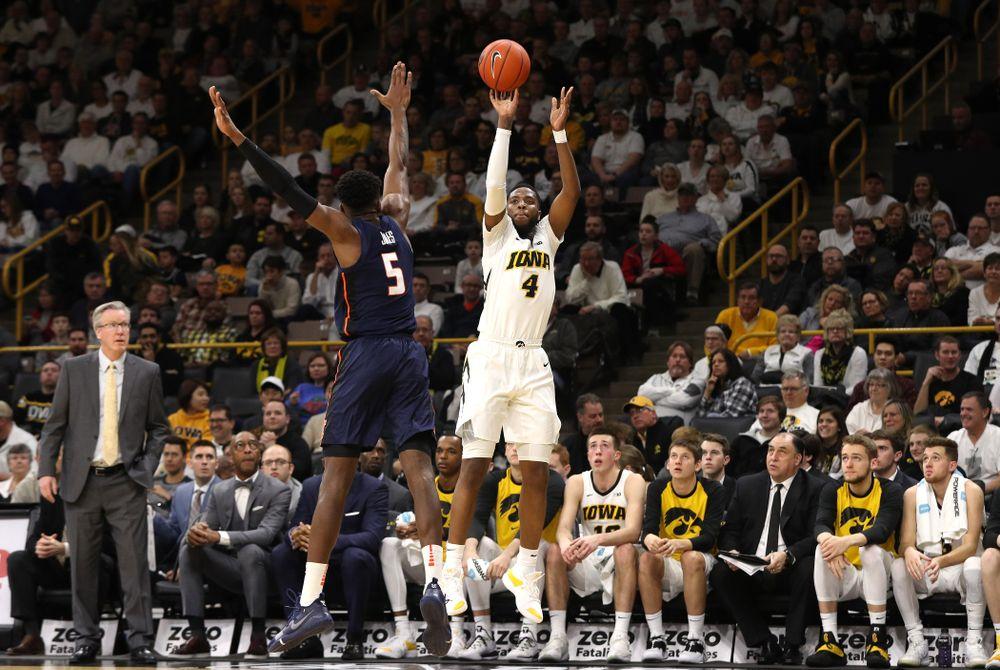 Iowa Hawkeyes guard Isaiah Moss (4) knocks down a three point basket against the Illinois Fighting Illini Sunday, January 20, 2019 (Brian Ray/hawkeyesports.com)