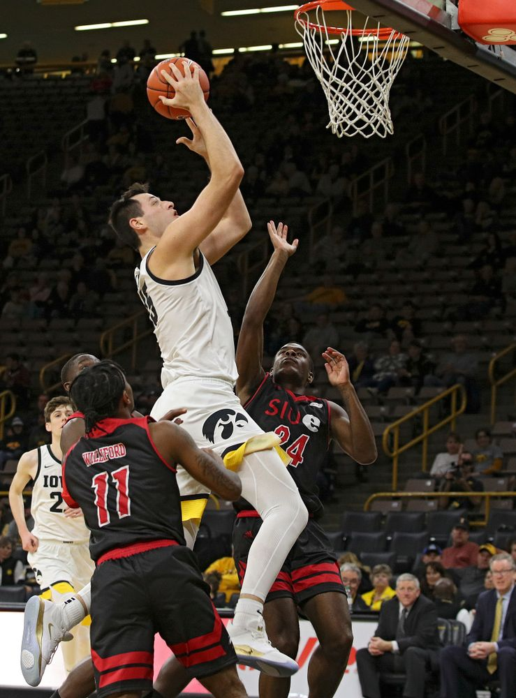 Iowa Hawkeyes forward Ryan Kriener (15) puts up a shot during the second half of their game at Carver-Hawkeye Arena in Iowa City on Friday, Nov 8, 2019. (Stephen Mally/hawkeyesports.com)