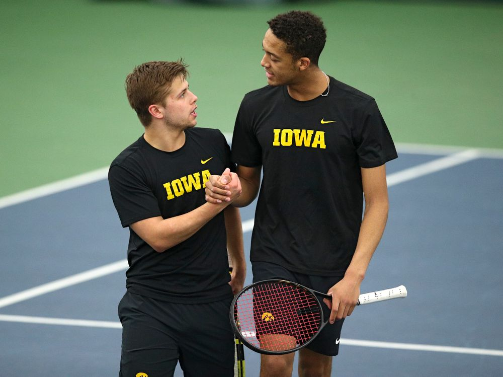 Iowa's Will Davies (from left) and Oliver Okonkwo celebrate after winning their doubles match at the Hawkeye Tennis and Recreation Complex in Iowa City on Friday, March 6, 2020. (Stephen Mally/hawkeyesports.com)