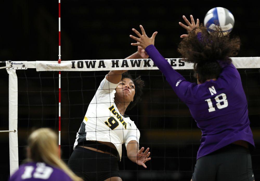 Iowa Hawkeyes middle blocker Amiya Jones (9) against the Northwestern Wildcats Wednesday, October 24, 2018 at Carver-Hawkeye Arena. (Brian Ray/hawkeyesports.com)