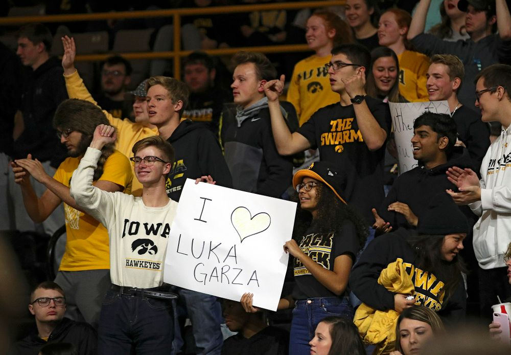 Iowa fans hold up a sign supporting center Luka Garza (not pictured) before their game at Carver-Hawkeye Arena in Iowa City on Friday, Nov 8, 2019. (Stephen Mally/hawkeyesports.com)