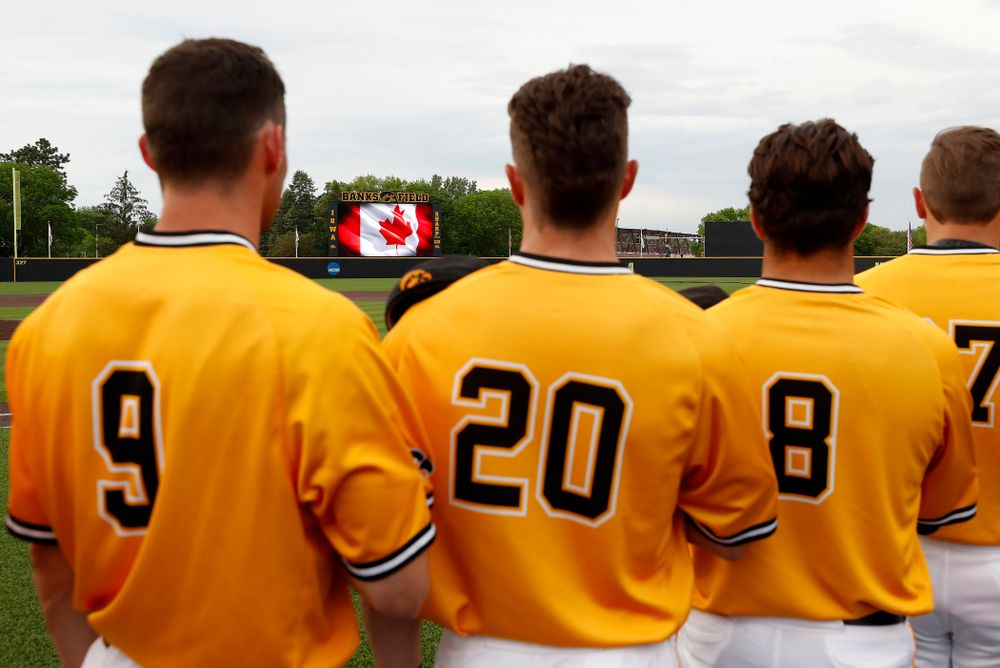 Iowa Hawkeyes catcher Austin Guzzo (20) stands for the Canadian National Anthem  before their game against the Penn State Nittany Lions Saturday, May 19, 2018 at Duane Banks Field. (Brian Ray/hawkeyesports.com)