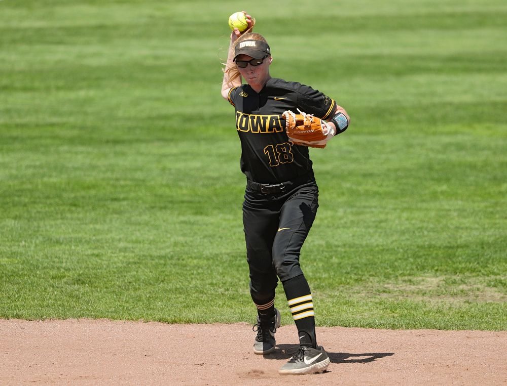 Iowa shortstop Ashley Hamilton (18) throws to first during the third inning of their game against Ohio State at Pearl Field in Iowa City on Saturday, May. 4, 2019. (Stephen Mally/hawkeyesports.com)