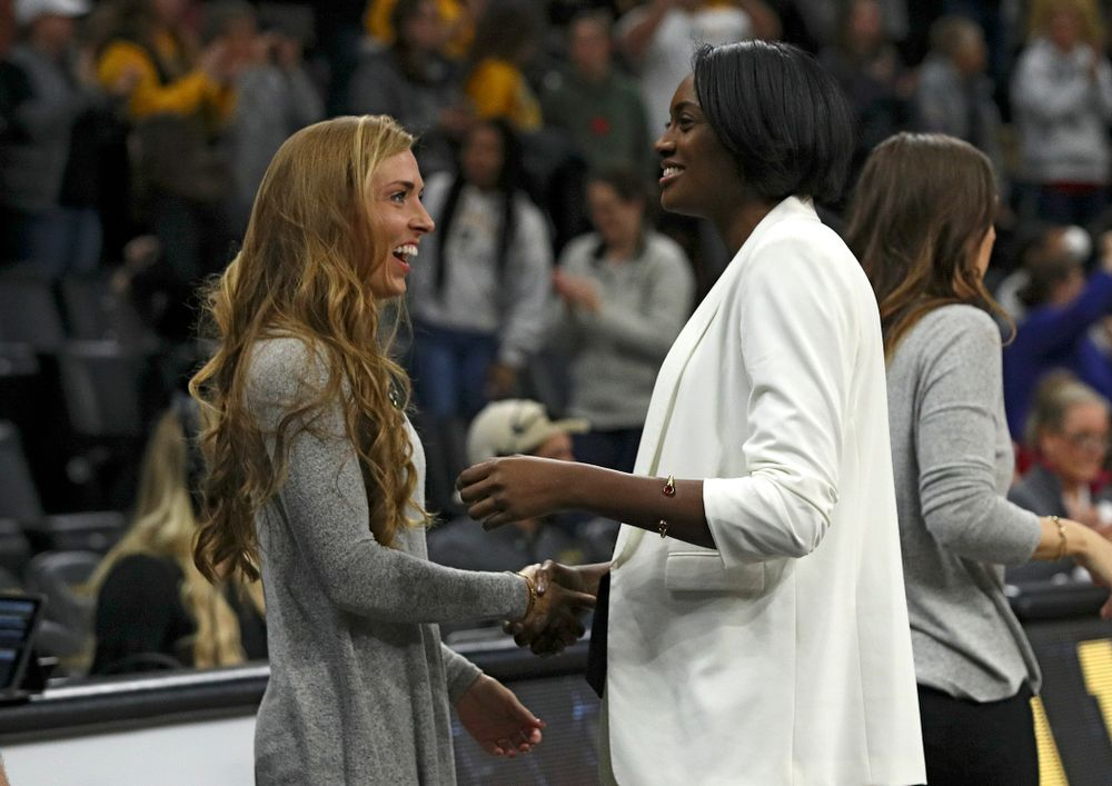 Iowa director of operations Emily Sparks (from left) shakes hands with head coach Vicki Brown after winning their match at Carver-Hawkeye Arena in Iowa City on Saturday, Nov 30, 2019. (Stephen Mally/hawkeyesports.com)