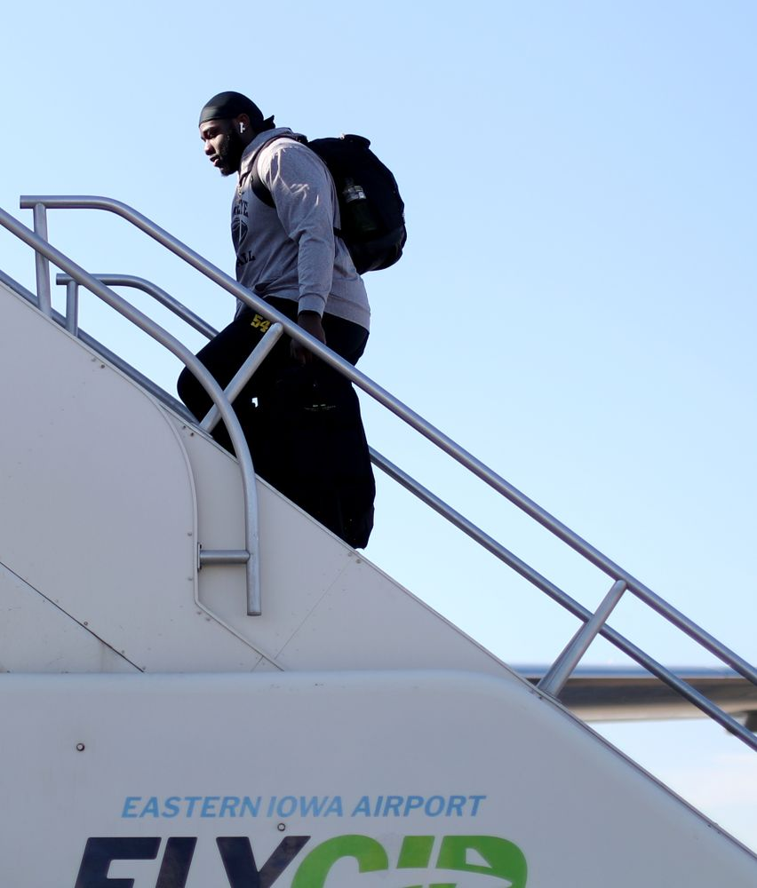 Iowa Hawkeyes defensive tackle Daviyon Nixon (54) boards the team plane at the Eastern Iowa Airport Saturday, December 21, 2019 on the way to San Diego, CA for the Holiday Bowl. (Brian Ray/hawkeyesports.com)