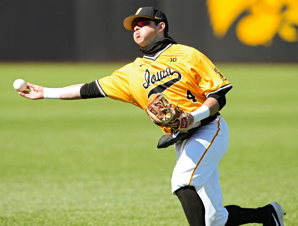 Iowa Hawkeyes second baseman Mitchell Boe (4) throws to first for an out during the eighth inning against Illinois at Duane Banks Field in Iowa City on Sunday, Mar. 31, 2019. (Stephen Mally/hawkeyesports.com)