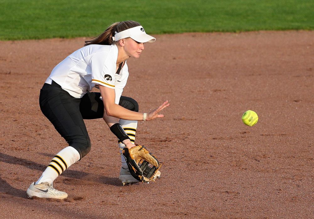 Iowa second baseman Aralee Bogar (2) fields a ground ball before turning an inning ending double play during the sixth inning of their game against Ohio State at Pearl Field in Iowa City on Friday, May. 3, 2019. (Stephen Mally/hawkeyesports.com)
