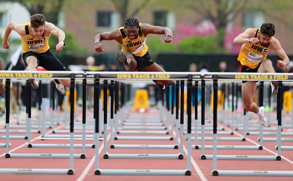 Iowa's Chris Douglas (from left), Anthony Williams, and Josh Braverman run the men's 110 meter hurdles event on the third day of the Big Ten Outdoor Track and Field Championships at Francis X. Cretzmeyer Track in Iowa City on Sunday, May. 12, 2019. (Stephen Mally/hawkeyesports.com)