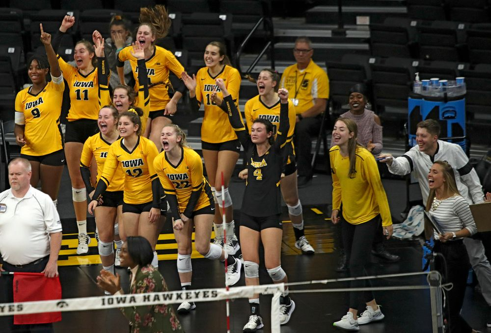 The Iowa bench celebrates a score during their match at Carver-Hawkeye Arena in Iowa City on Sunday, Oct 20, 2019. (Stephen Mally/hawkeyesports.com)