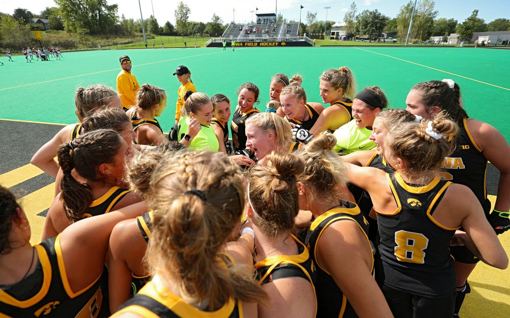 The Iowa Hawkeyes huddle before the start of their match at Grant Field in Iowa City on Friday, Oct 4, 2019. (Stephen Mally/hawkeyesports.com)