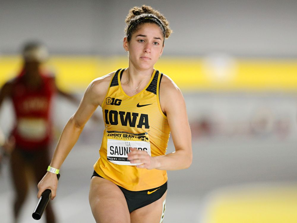 Iowa's Tia Saunders runs the women's 1600 meter relay event during the Jimmy Grant Invitational at the Recreation Building in Iowa City on Saturday, December 14, 2019. (Stephen Mally/hawkeyesports.com)