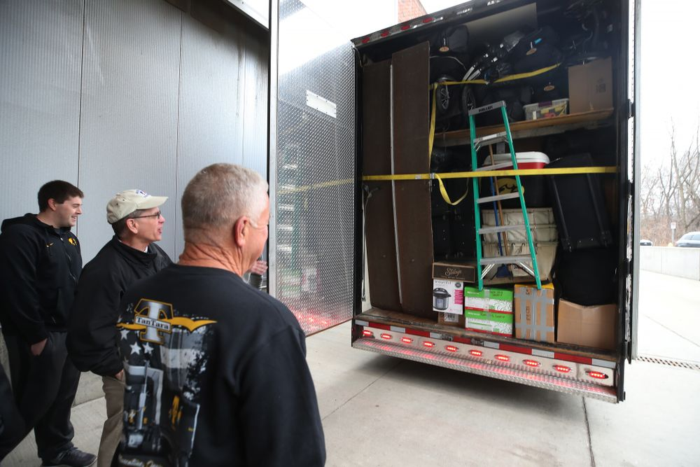 TanTara Transportation Corporation President Mike Riggan and head football equipment manager Greg Morris prepare to lock up the trailer before departing for Tampa, Florida Friday, December 21, 2018 at the Hansen Football Performance Center. (Brian Ray/hawkeyesports.com)