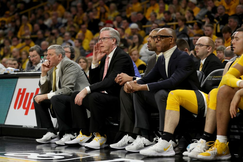 The Iowa Hawkeyes coaching staff wears sneakers with their suits against the Rutgers Scarlet Knights  Wednesday, January 22, 2020 at Carver-Hawkeye Arena. (Brian Ray/hawkeyesports.com)