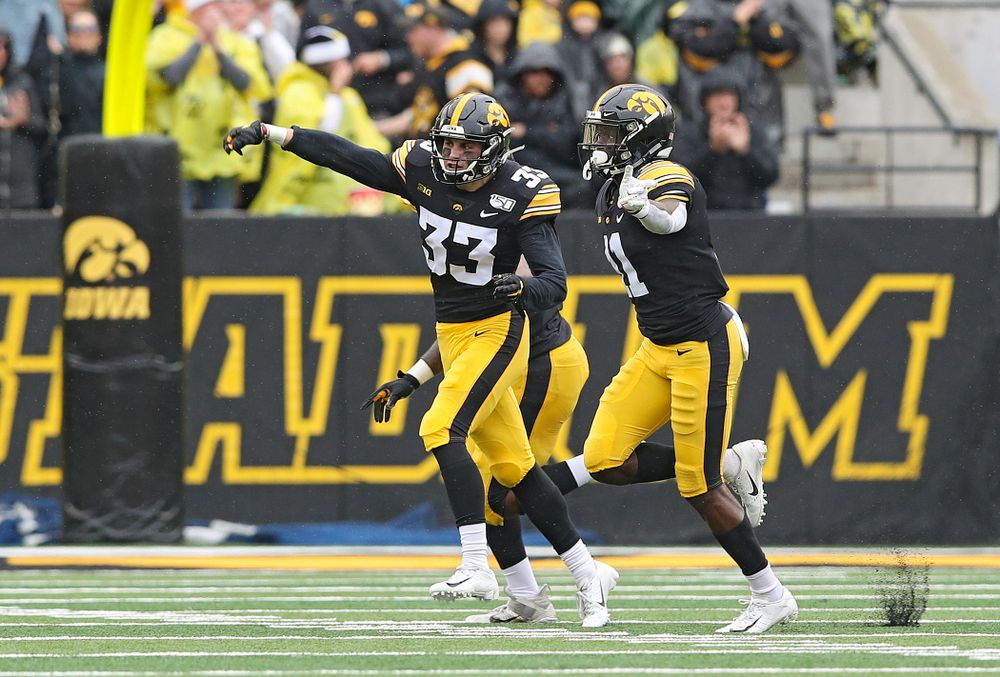 Iowa Hawkeyes defensive back Riley Moss (33) celebrates after intercepting a pass during the third quarter of their game at Kinnick Stadium in Iowa City on Saturday, Oct 19, 2019. (Stephen Mally/hawkeyesports.com)