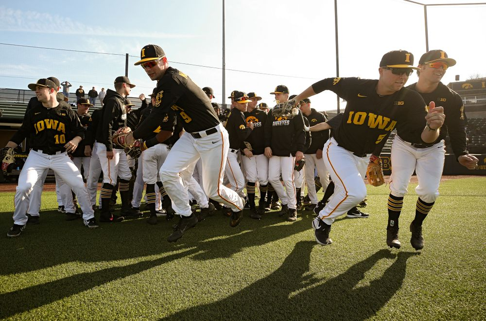The Hawkeyes take the field before their college baseball game at Duane Banks Field in Iowa City on Tuesday, March 10, 2020. (Stephen Mally/hawkeyesports.com)