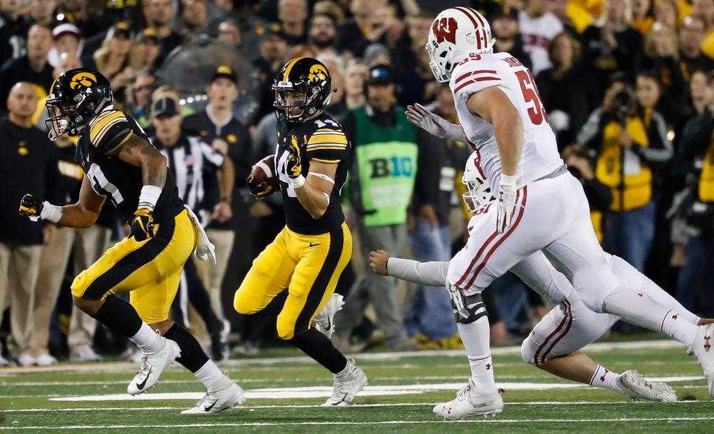 Iowa Hawkeyes wide receiver Kyle Groeneweg (14) runs the ball during a game against Wisconsin at Kinnick Stadium on September 22, 2018. (Tork Mason/hawkeyesports.com)