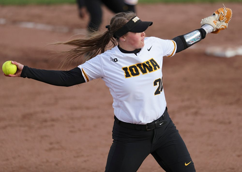 Iowa pitcher Miranda Schulte (20) delivers to the plate during the fifth inning of their game against Illinois at Pearl Field in Iowa City on Friday, Apr. 12, 2019. (Stephen Mally/hawkeyesports.com)