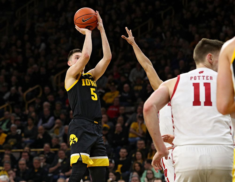 Iowa Hawkeyes guard CJ Fredrick (5) makes a basket during the second half of their game at Carver-Hawkeye Arena in Iowa City on Monday, January 27, 2020. (Stephen Mally/hawkeyesports.com)