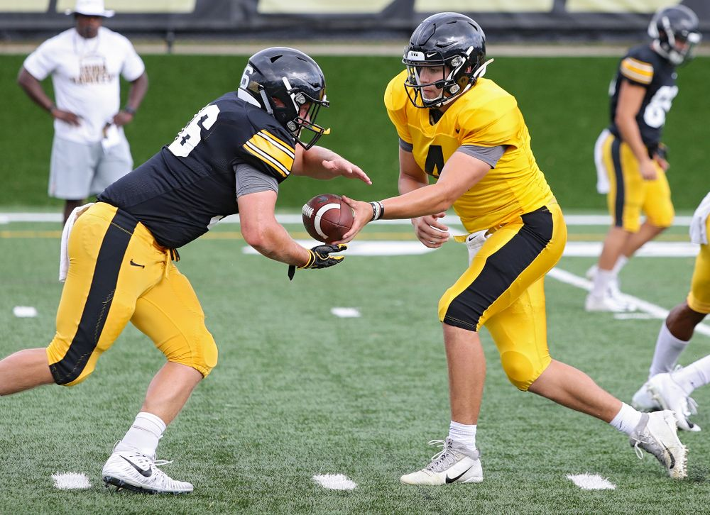 Iowa Hawkeyes quarterback Nate Stanley (4) hands the ball off to fullback Brady Ross (36) during Fall Camp Practice No. 10 at the Hansen Football Performance Center in Iowa City on Tuesday, Aug 13, 2019. (Stephen Mally/hawkeyesports.com)