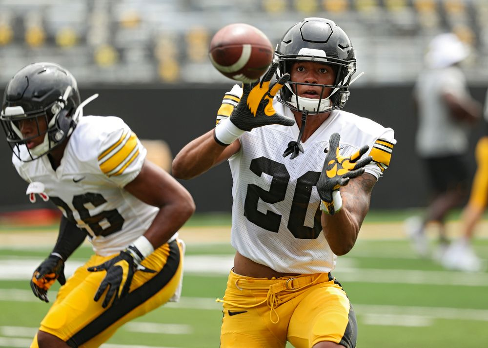 Iowa Hawkeyes defensive back Julius Brents (20) pulls in a pass during Fall Camp Practice No. 8 at Kids Day at Kinnick Stadium in Iowa City on Saturday, Aug 10, 2019. (Stephen Mally/hawkeyesports.com)