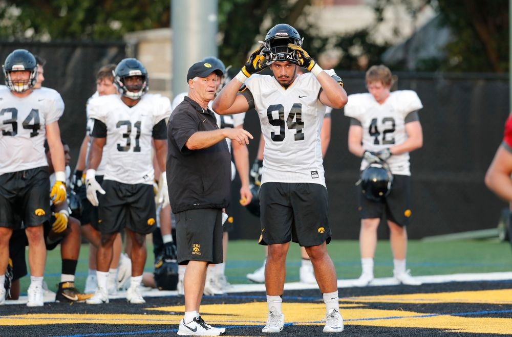 Defensive Line Coach Reese Morgan and defensive end A.J. Epenesa (94) during fall camp practice No. 4 Wednesday, August 2, 2017 at the Kenyon Football Practice Facility. (Brian Ray/hawkeyesports.com)