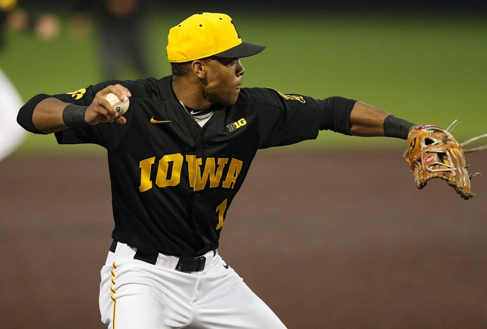 Iowa Hawkeyes third baseman Lorenzo Elion (1) throws to first for an out after fielding a ground ball during the sixth inning of their game against Western Illinois at Duane Banks Field in Iowa City on Wednesday, May. 1, 2019. (Stephen Mally/hawkeyesports.com)