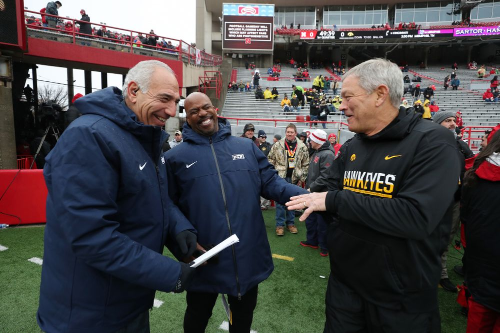Iowa Hawkeyes head coach Kirk Ferentz talks with BTNÕs Howard Griffith and Gerry DiNardo before their game against the Nebraska Cornhuskers Friday, November 29, 2019 at Memorial Stadium in Lincoln, Neb. (Brian Ray/hawkeyesports.com)