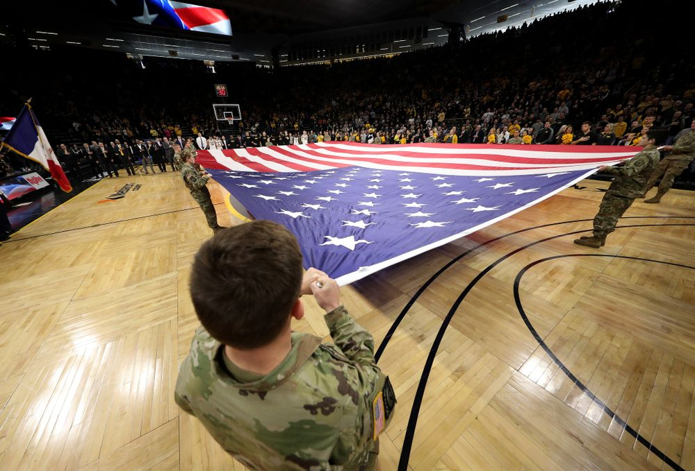 Members of the Iowa Army ROTC display a large American flag before the Iowa Hawkeyes game against Penn State Saturday, February 29, 2020 at Carver-Hawkeye Arena. (Brian Ray/hawkeyesports.com)