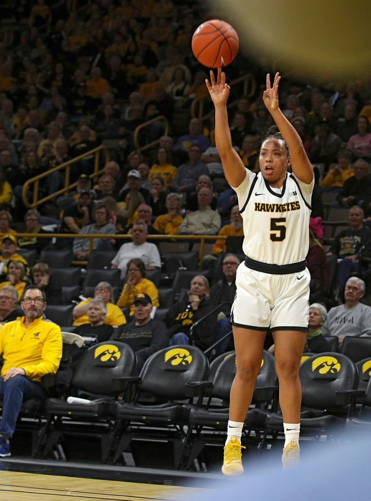 Iowa Hawkeyes guard Alexis Sevillian (5) makes a 3-pointer during the first quarter of the game at Carver-Hawkeye Arena in Iowa City on Thursday, February 6, 2020. (Stephen Mally/hawkeyesports.com)