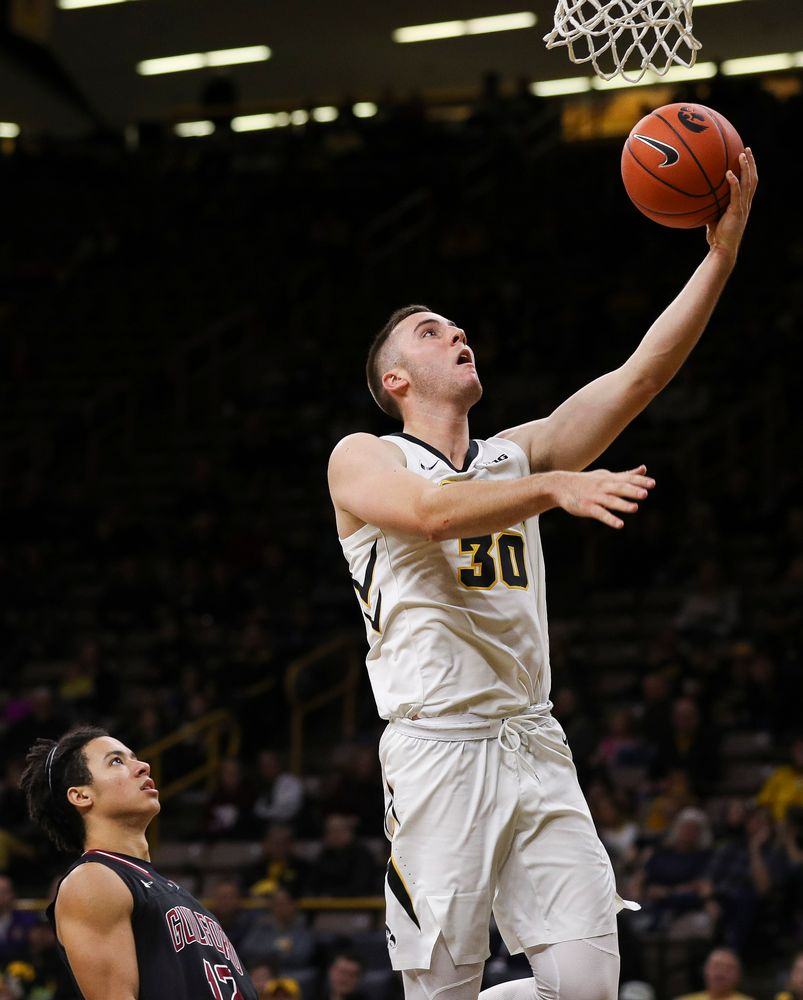 Iowa Hawkeyes guard Connor McCaffery (30) goes up for a layup during a game against Guilford College at Carver-Hawkeye Arena on November 4, 2018. (Tork Mason/hawkeyesports.com)