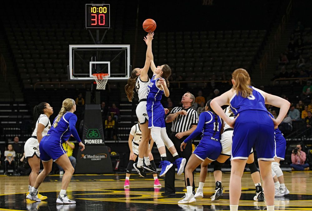 Iowa Hawkeyes forward Amanda Ollinger (43) wins the opening tip off during the first quarter of their game at Carver-Hawkeye Arena in Iowa City on Saturday, December 21, 2019. (Stephen Mally/hawkeyesports.com)