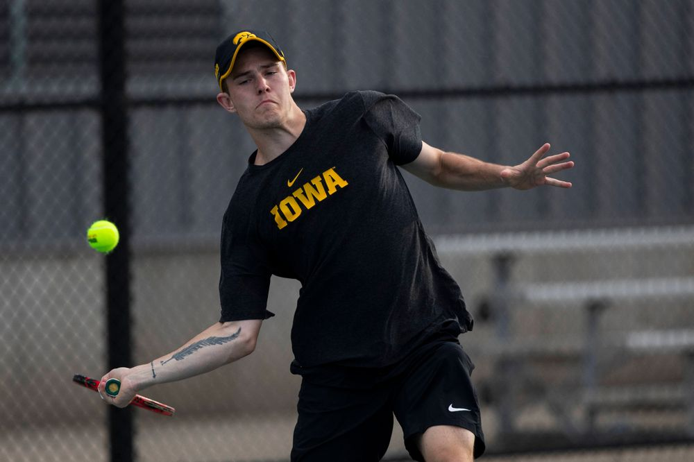 IowaÕs Jonas Larsen at tennis vs Illinois State on Sunday, April 21, 2019 at the Hawkeye Tennis and Recreation Complex. (Lily Smith/hawkeyesports.com)