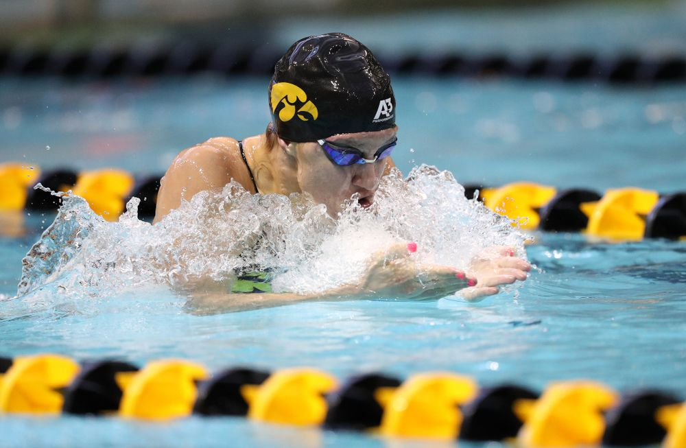 Iowa's Sage Ohlensehlen swims the breaststroke leg of the 200 yard medley relay during a double dual against Wisconsin and Northwestern Saturday, January 19, 2019 at the Campus Recreation and Wellness Center. (Brian Ray/hawkeyesports.com)