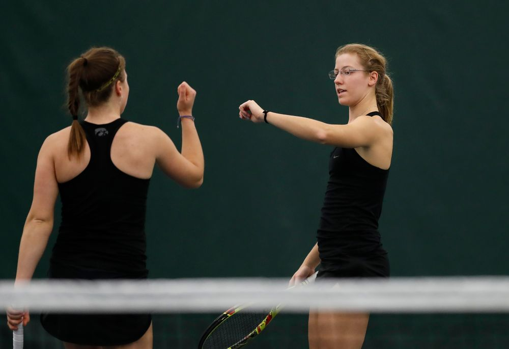 Iowa's Anastasia Reimchen and Montana Crawford play a doubles match against Marquette
