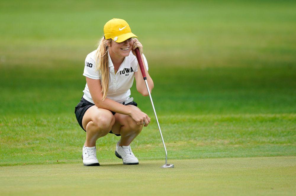Iowa's Morgan Goldstein smiles as she waits to putt during their dual against Northern Iowa at Pheasant Ridge Golf Course in Cedar Falls on Monday, Sep 2, 2019. (Stephen Mally/hawkeyesports.com)