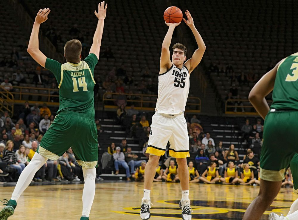 Iowa Hawkeyes center Luka Garza (55) makes a 3-pointer during the second half of their game at Carver-Hawkeye Arena in Iowa City on Sunday, Nov 24, 2019. (Stephen Mally/hawkeyesports.com)