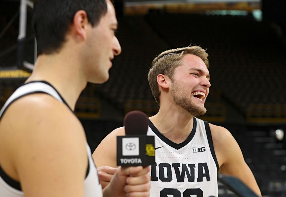 Iowa Hawkeyes forward Riley Till (20) laughs as forward Ryan Kriener (15) answers a question from him during Iowa Men's Basketball Media Day at Carver-Hawkeye Arena in Iowa City on Wednesday, Oct 9, 2019. (Stephen Mally/hawkeyesports.com)