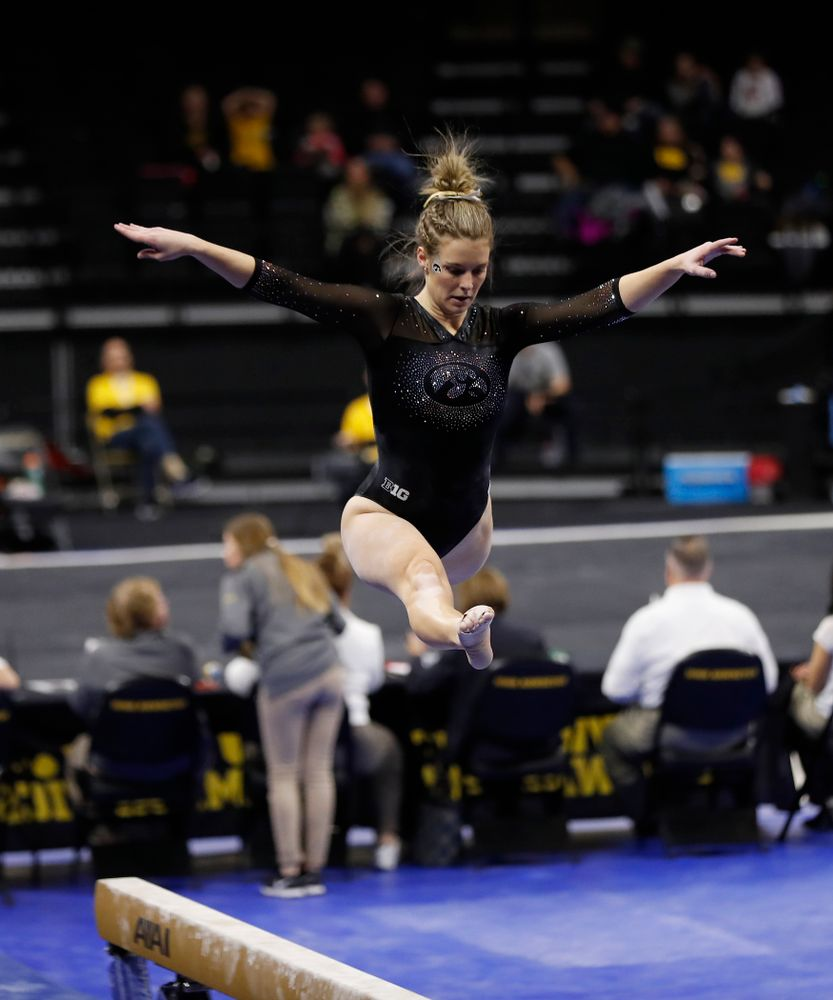 Sydney Hogan competes on the beam