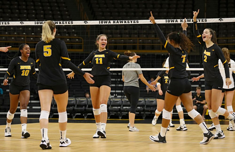 Iowa's Blythe Rients (11) celebrates with her teammates after a score during the first set of the Black and Gold scrimmage at Carver-Hawkeye Arena in Iowa City on Saturday, Aug 24, 2019. (Stephen Mally/hawkeyesports.com)