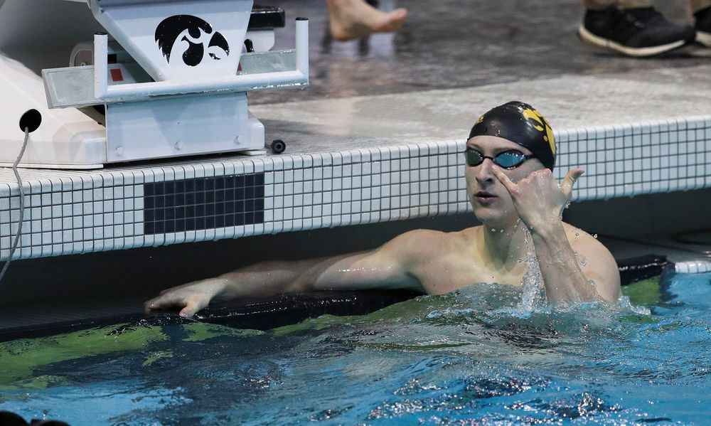 Iowa's Joe Myhre reacts after winning the 100-yard freestyle during a meet against Michigan and Denver at the Campus Recreation and Wellness Center on November 3, 2018. (Tork Mason/hawkeyesports.com)