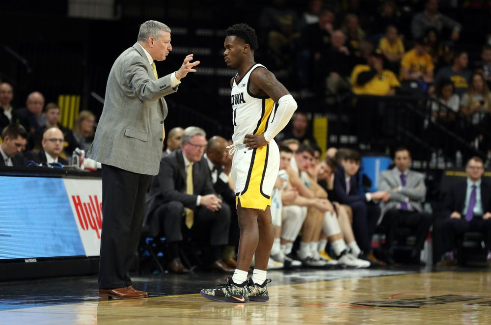 Iowa Hawkeyes guard Joe Toussaint (1) and assistant coach Kirk Speraw against Oral Roberts Friday, November 15, 2019 at Carver-Hawkeye Arena. (Brian Ray/hawkeyesports.com)