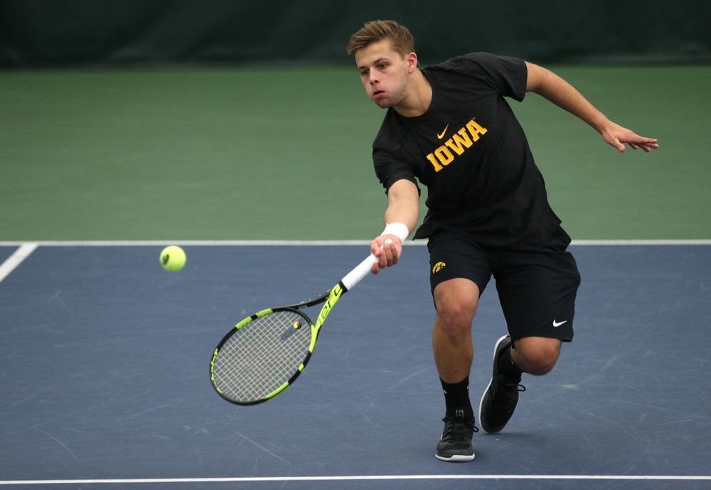 Will Davies and Oliver Okonkwo plays a doubles match against the Miami Hurricanes Friday, February 8, 2019 at the Hawkeye Tennis and Recreation Complex. (Brian Ray/hawkeyesports.com)