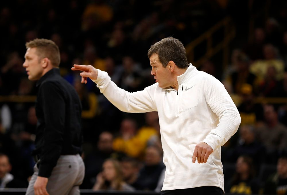 Iowa's Vince Turk against Michigan's Sal Profaci at 141 pounds
