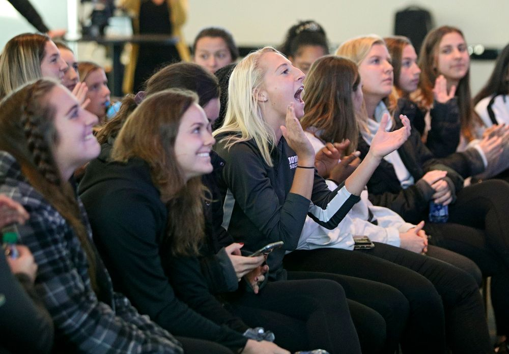Iowa defender Samantha Cary (9) claps as she watches the NCAA women's soccer section show with her team at Carver-Hawkeye Arena in Iowa City on Monday, Nov 11, 2019. (Stephen Mally/hawkeyesports.com)