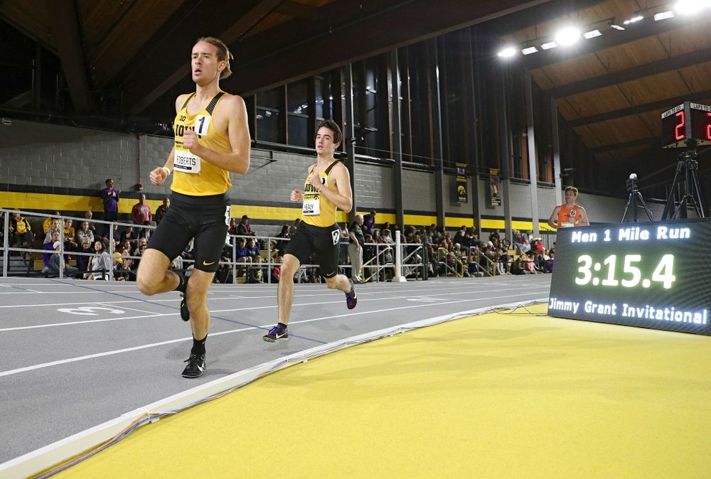 Iowa's Jeff Roberts (from left) and Noah Healy run the men's 1 mile run event during the Jimmy Grant Invitational at the Recreation Building in Iowa City on Saturday, December 14, 2019. (Stephen Mally/hawkeyesports.com)