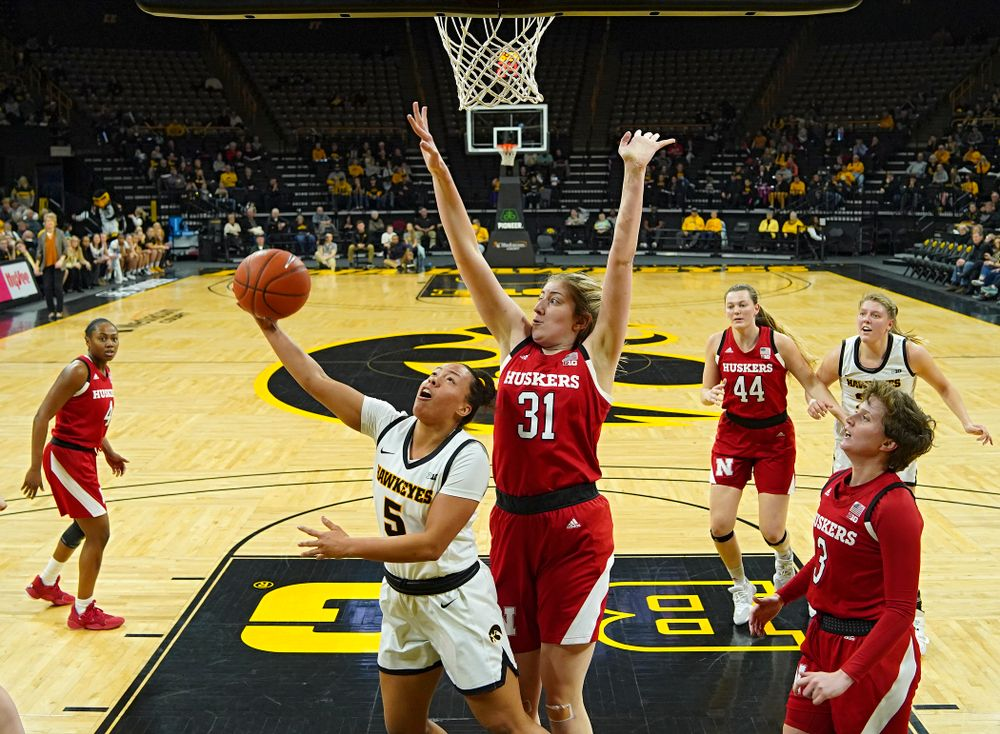 Iowa Hawkeyes guard Alexis Sevillian (5) makes a basket during the second quarter of the game at Carver-Hawkeye Arena in Iowa City on Thursday, February 6, 2020. (Stephen Mally/hawkeyesports.com)