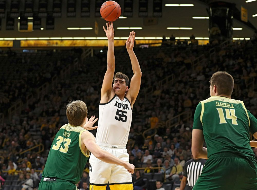 Iowa Hawkeyes center Luka Garza (55) makes a basket during the first half of their game at Carver-Hawkeye Arena in Iowa City on Sunday, Nov 24, 2019. (Stephen Mally/hawkeyesports.com)