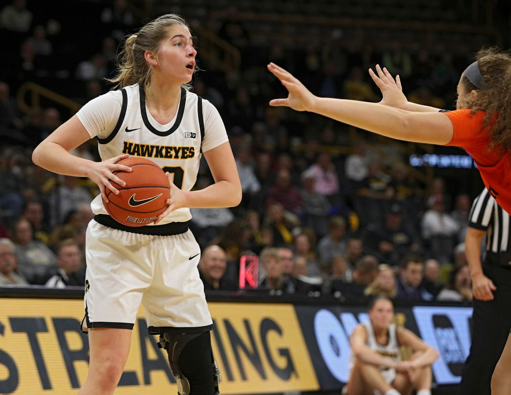 Iowa guard Kate Martin (20) looks to pass during the first quarter of their overtime win against Princeton at Carver-Hawkeye Arena in Iowa City on Wednesday, Nov 20, 2019. (Stephen Mally/hawkeyesports.com)