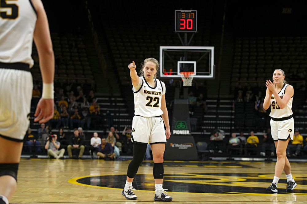 Iowa Hawkeyes guard Kathleen Doyle (22) points to forward Monika Czinano (25) after she made a basket while being fouled as forward Amanda Ollinger (43) claps during the second quarter of the game at Carver-Hawkeye Arena in Iowa City on Thursday, February 6, 2020. (Stephen Mally/hawkeyesports.com)